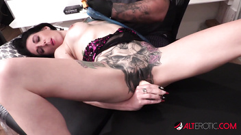 Busty Marie Bossette masturbates while getting a tattoo