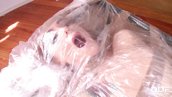 Submissive Leyla Black wraped in plastic and sticky tape for anal fetish
