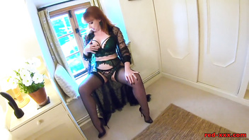 Redhead mature Red XXX gets off with her toy