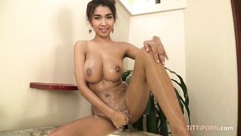 Enormous naturals on hot Thai babe