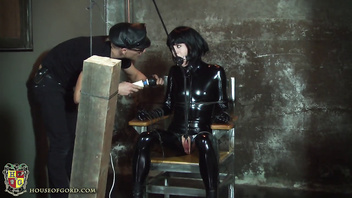 Mouth plugged rubber doll vibed