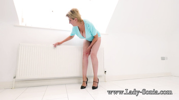 British mature Lady Sonia teases as she cleans