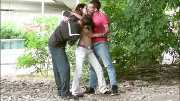 Skinny girl with small tits is double teamed by 2 guys fucking her in public