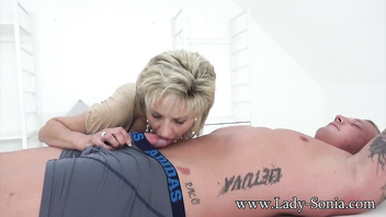 Hot Euro MILF jerks off hung stud and savors his cum